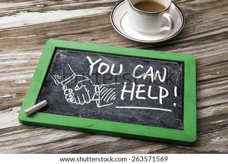 you can help handwritten on blackboard - stock photo