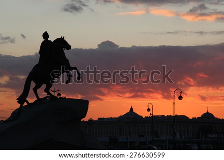 You can see amazing dark silhouette of Peter the great, founder of Saint Petersburg, who enjoys an amazing sunset and their city.