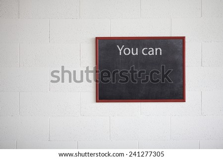 You can, writing on chalkboard - stock photo
