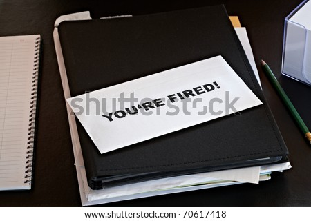 you're fired letter on paperwork - stock photo