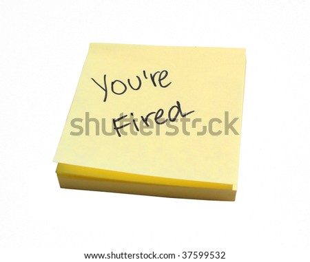 You're Fired on a post it note - stock photo