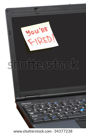 You're Fired! post-it note on notebook screen - stock photo