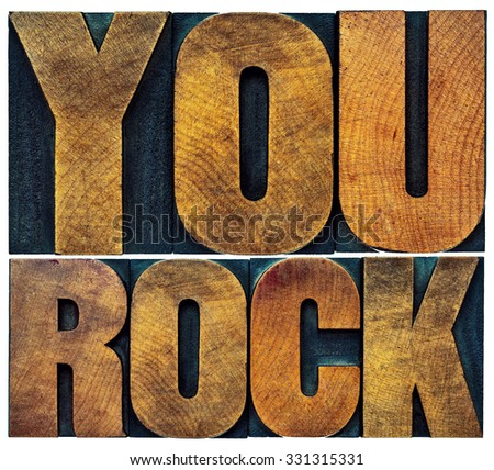 you rock word abstract - isolated text in grunge letterpress wood type - stock photo