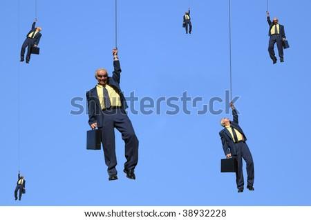 you've been suspended ! Business men having been suspended. - stock photo