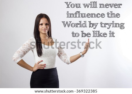 You will never influence the World by trying to be like it - Beautiful businesswoman pointing - horizontal image - stock photo