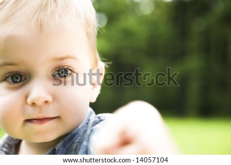 You! Young Baby Playing On Meadow. - stock photo