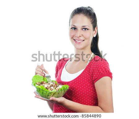 Youg women eating serrate chicken with cheese and salad - stock photo