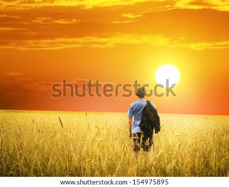 youn man on yellow wheat meadow. Conceptual design. - stock photo