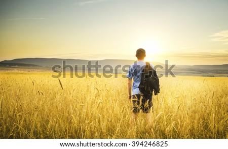 youn man on yellow wheat meadow. Conceptual design. - stock photo