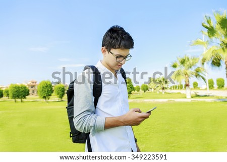 Youn man with backpack bag and mobile outdoor. - stock photo