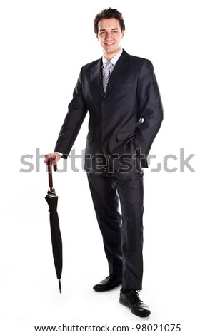 Young, a respected and successful businessman in a dark business suit with an umbrella - stock photo