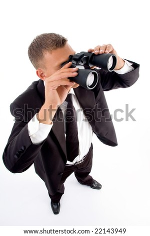 young accountant looking through binoculars on an isolated white background - stock photo