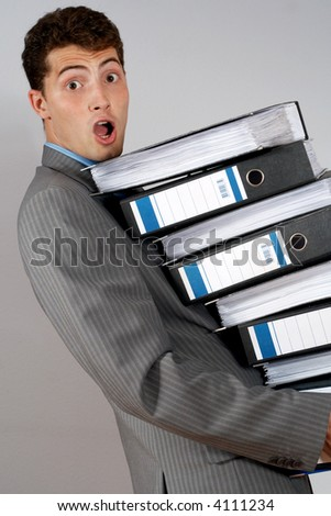 young accountant with pile of documents