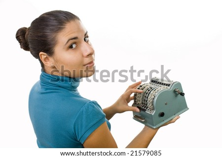 young accountant women with obsolete computing machine - stock photo