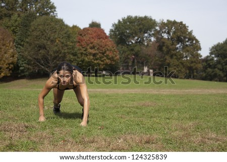 Young active female running in nature - stock photo
