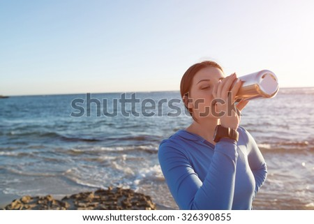 Young active girl jogger on beach taking breath - stock photo