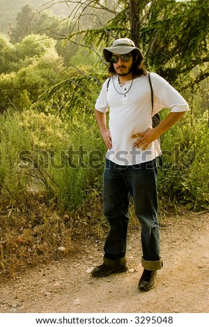 Young active man hiking outdoors
