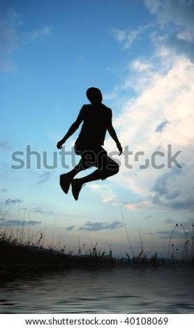 Young active man jumping, darkness
