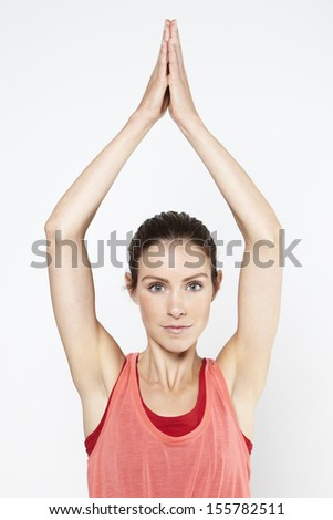 Young active woman doing yoga