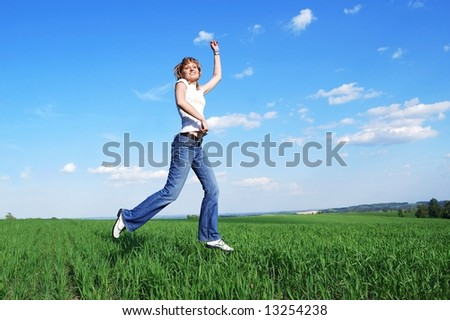 Young active woman running at the field - stock photo