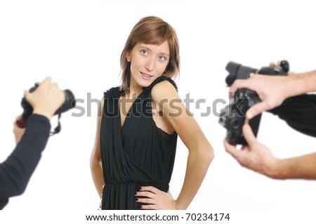 Young actress smiling at photographers - stock photo