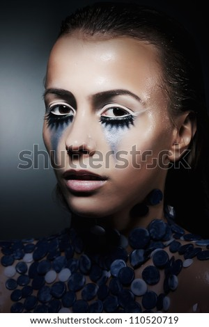 Young actress woman with creative paint make up. Theatrical stage - stock photo