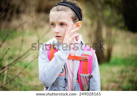 Young adorable kid girl crying and upset after school - stock photo