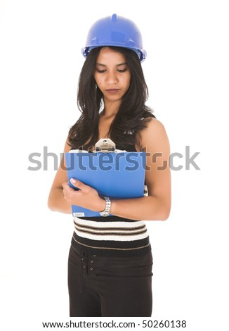 Young adult African-Indian businesswoman in casual office outfit with a clipboard and hard hat on a white background. Not Isolated - stock photo