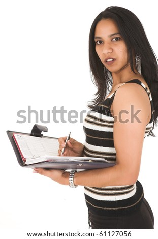Young adult African-Indian businesswoman in casual office outfit with a striped brown top writing in a daybook on a white background. Not Isolated