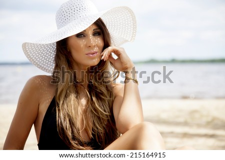 Young adult attractive sexy and sensuality beautiful brunette woman in bikini on the beach - stock photo
