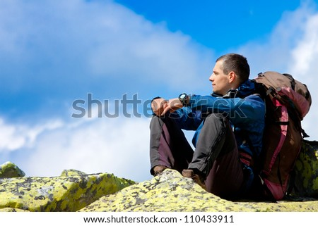 young adult backpacker have a rest - stock photo