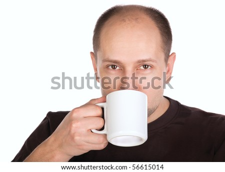 Young adult balding man drinking tea