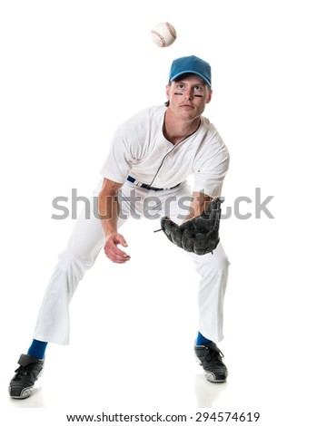 Young adult baseball player. Studio shot over white.