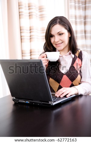 young adult brunette woman with laptop - stock photo
