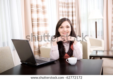 young adult brunette woman with laptop