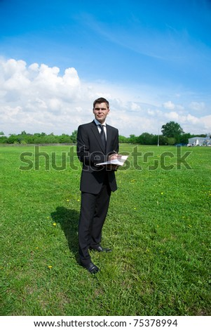 young adult businessman working in country