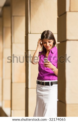 young adult businesswoman reading phone message on mobile phone. Copy space