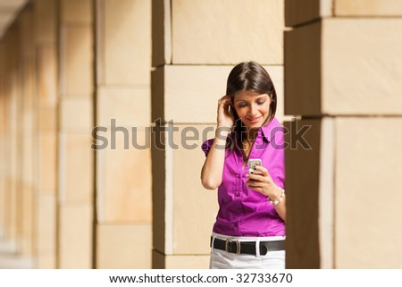 young adult businesswoman reading phone message on mobile phone. Copy space - stock photo