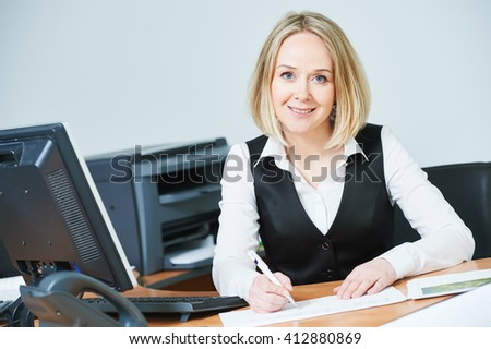 Young adult businesswoman with computer at workplace  - stock photo