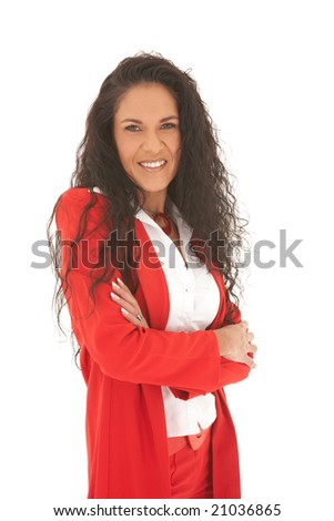 Young adult Caucasian businesswoman wearing a red suit with long brown hair and crossed arms. NOT ISOLATED