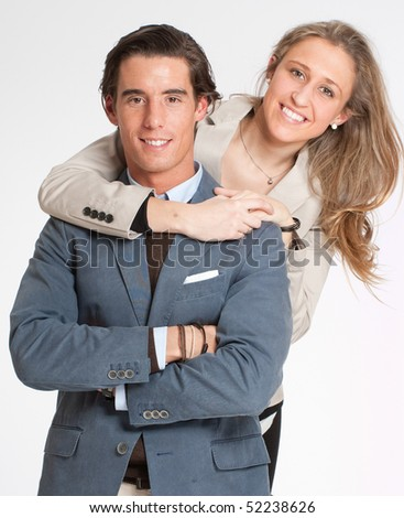 Young adult couple embracing against a white background - stock photo