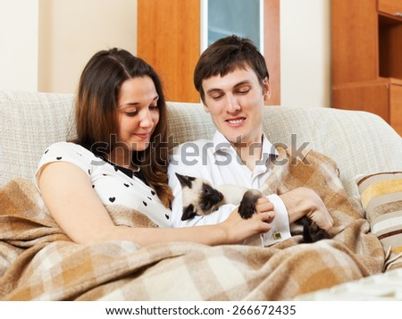 Young adult couple in home interior