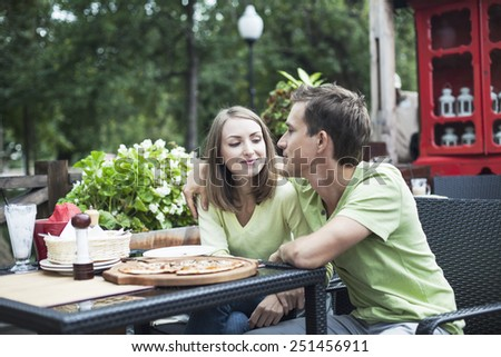 Young adult couple in the cafe - stock photo