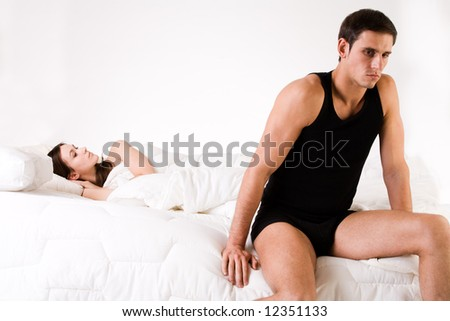Young adult couple in the studio on a bed