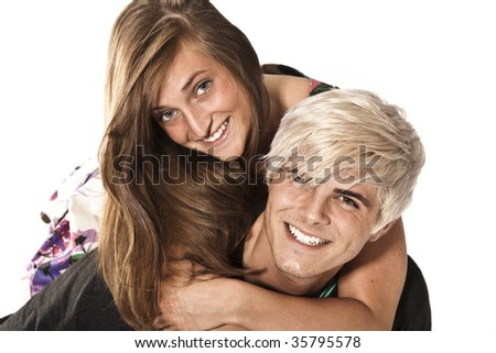 Young adult couple playing around - piggyback - stock photo