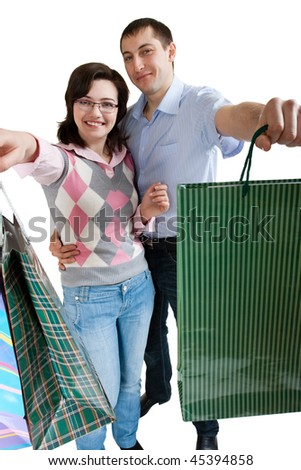 young adult couple shopping on white background