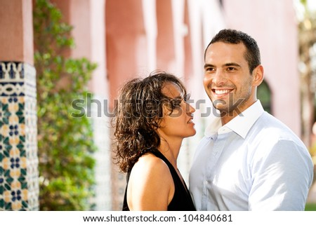 Young adult couple smiling outdoors - stock photo