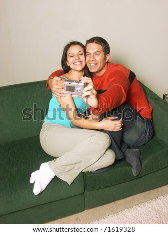 Young adult couple taking a picture together. - stock photo