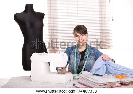 young adult fashion designer at work