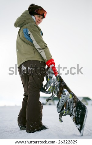 young adult female snowboarder